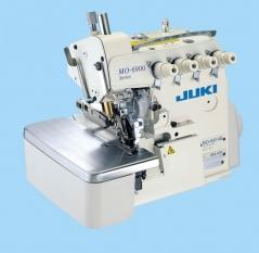 Máquina de costura Juki MO 6914S-BD6-307 - 2 agulhas 4 fios, com motor servo, tampo e bancada nacional